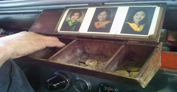 Jeepney-Driver-Goes-Viral-For-Proudly-Displaying-Photos-Of-His-College-Graduate-Kids